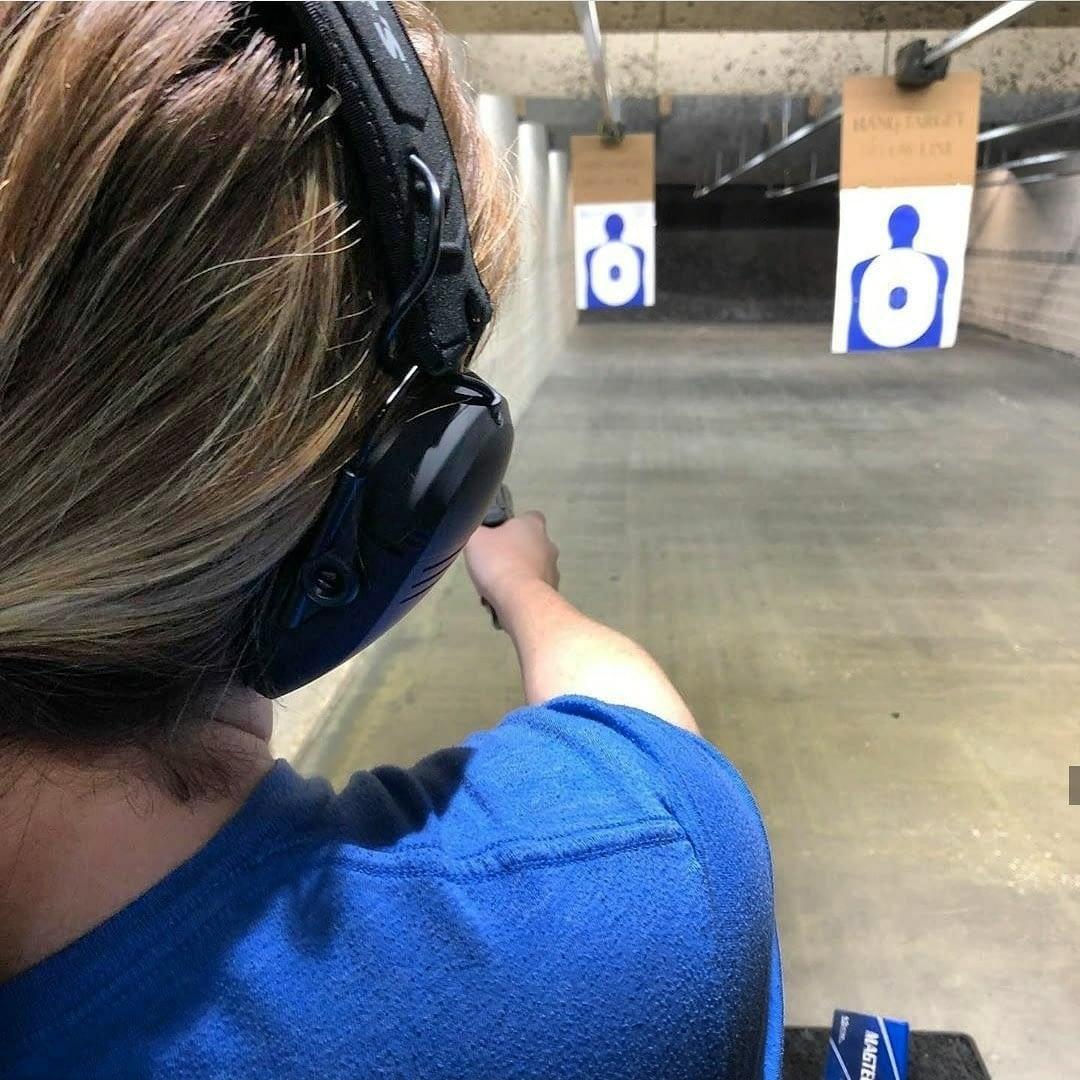 girl shooting in gun range